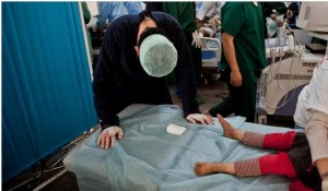Jinan Hussein Jweil, 5, was treated at a triage center in Misurata, Libya, for a serious wound on the right side of her head.
