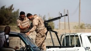 Government troops have been securing militia bases in Benghazi